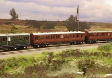 SS C888 houten coupé rijtuig in een trein op Oosterbeek-Hoog, een modelbaan van leden van team Mitropa